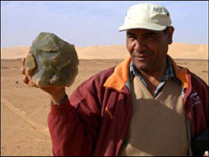 Aly Bakarat holding preserved rock